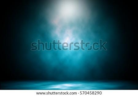 Blue spotlight smoke studio entertainment background.