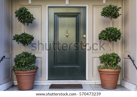 Front door, black front door Royalty-Free Stock Photo #570473239