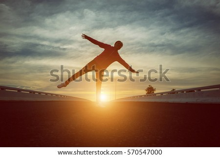 silhouette of woman pointing with finger in sky  #570547000