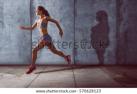 Running woman with a fat shadow #570628123