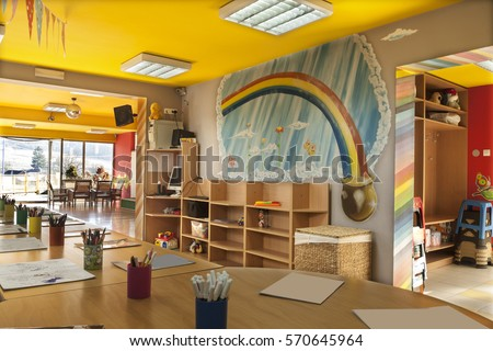 A day care center for children with mottled walls and lots of toys #570645964