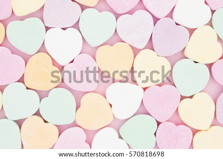 Old fashion pale multi colored candy heart background