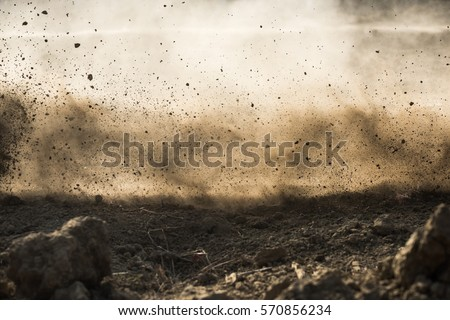 dirt fly after motocross roaring by Royalty-Free Stock Photo #570856234