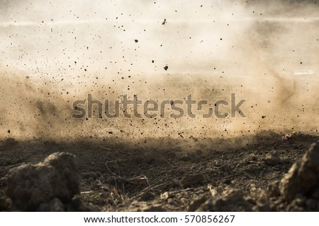 dirt fly after motocross roaring by Royalty-Free Stock Photo #570856267