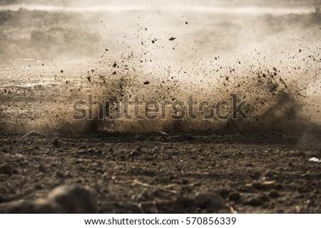 dirt fly after motocross roaring by Royalty-Free Stock Photo #570856339