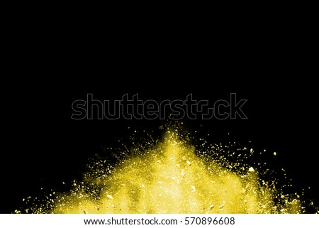 abstract yellow powder splatted background,Freeze motion of color powder exploding/throwing color powder,color glitter texture on black background #570896608