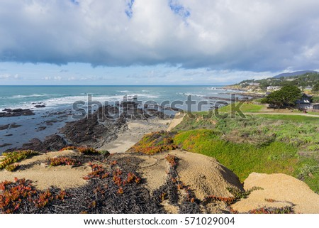View towards Fitzgerald Marine Reserve at low tide from the path on the bluffs, Moss Beach, California Royalty-Free Stock Photo #571029004