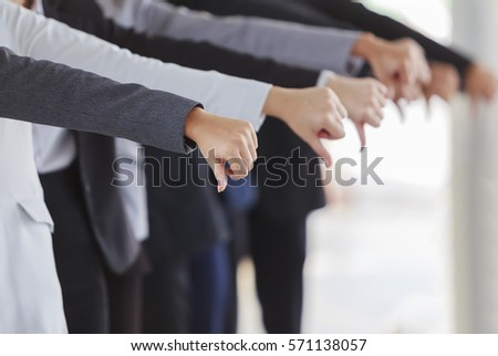 Large group of business people showing thumbs down.,Thinking sad businessman.,Dislike sign, thumb down.,fine portrait of team leader young businessman showing thumbs down, #571138057