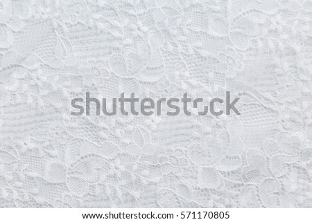 White lace with small flowers on the white background. No any trademark or restrict matter in this photo. Royalty-Free Stock Photo #571170805