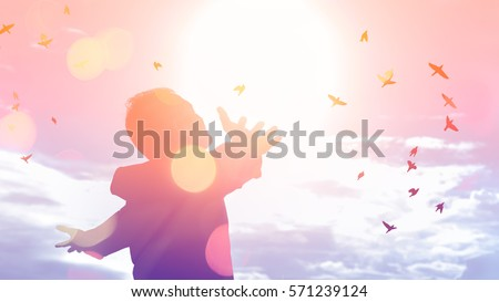 Freedom feel good and travel adventure concept. Copy space of silhouette man rising hands on sunset sky double exposure colorful bokeh and bird fly background. Vintage tone filter effect color style.  Royalty-Free Stock Photo #571239124