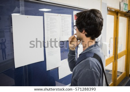 Student reading notice board in college #571288390