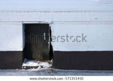 A small door on the black and white background #571351450