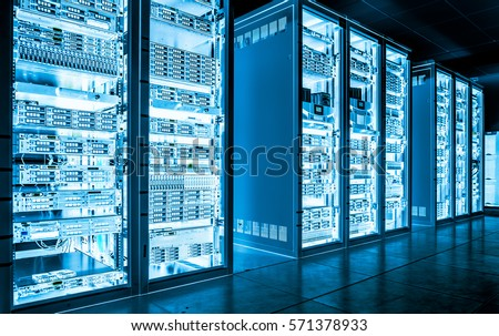Big data dark server room with bright blue equipment Royalty-Free Stock Photo #571378933