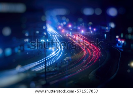 colorful light trace from night traffic in the city #571557859