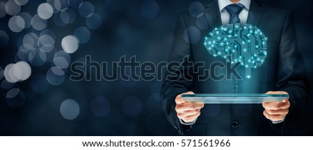 Artificial intelligence (AI), machine and deep learning and another modern computer technologies concepts. Brain representing artificial intelligence with printed circuit board (PCB) design. Royalty-Free Stock Photo #571561966