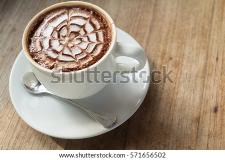 The Beautiful Texture of Hot Coffee Top in The Coffee Cup on Wooden Table. Set as Blank Frame for Text #571656502