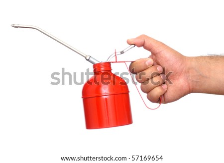 Hand holding red oil can #57169654