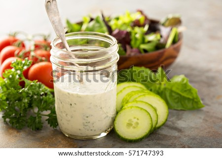 Homemade ranch dressing in a mason jar with fresh vegetables Royalty-Free Stock Photo #571747393