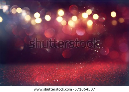 Red glitter vintage lights background. defocused Royalty-Free Stock Photo #571864537