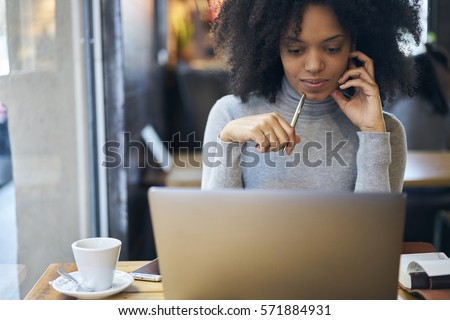 Confident successful female administrative manager of trading corporation making online parley with business partners discussing details of collaboration using laptop computer and free wifi connection #571884931