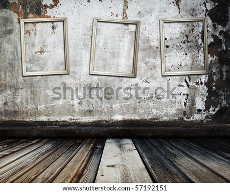 Old grunge room with picture frames