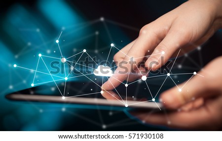 Female hands touching tablet with white cloud concept Royalty-Free Stock Photo #571930108