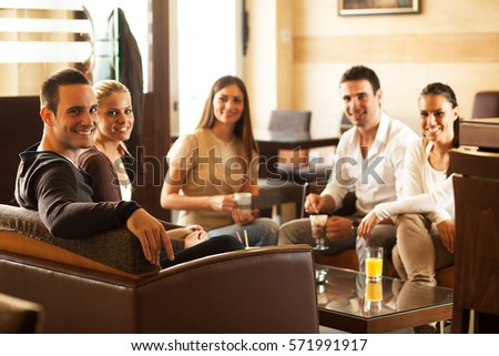 Group of friends hanging out at the cafe. #571991917