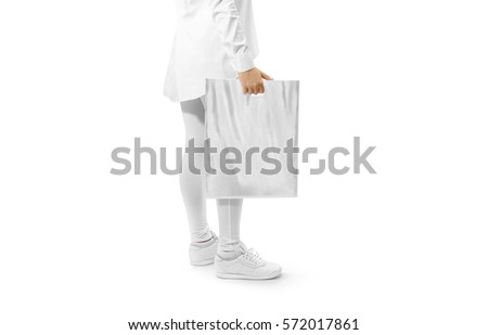 Blank grey plastic bag mockup holding hand. Woman hold gray carrier sac mock up. Plain bagful branding template. Shopping carry package in persons arm. Promotional packet for logotype branding. #572017861