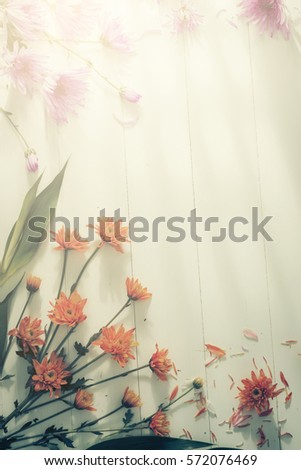 Flowers with shadow of wooden battens on white wooden table background on Valentine's Day times with copy space. #572076469
