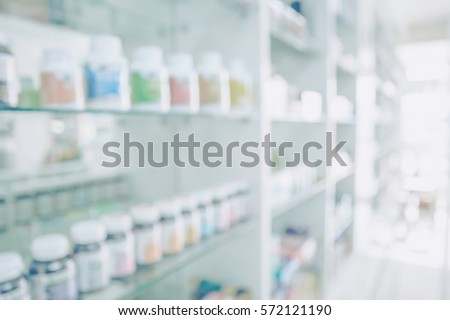 Pharmacy blurred light tone with store drugs shelves interior background, Concept of pharmacist, middle east or transcontinental region centered on western asia. Background of pharmacy store. Royalty-Free Stock Photo #572121190
