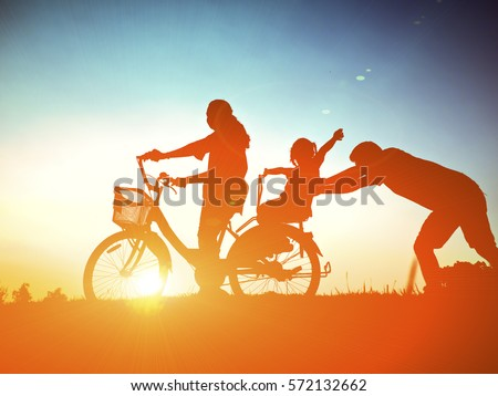 Biker family silhouette father and daughter
