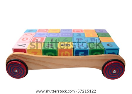 children toy letter building blocks all together in a toy cart isolated on white background #57215122