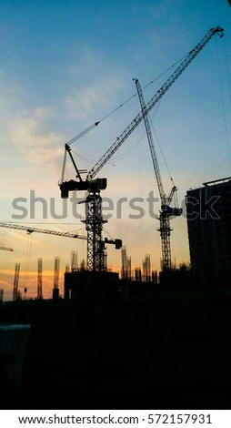 The working crane in the morning with beautiful sky. #572157931