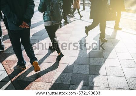 people walking in the street, (blur focus)