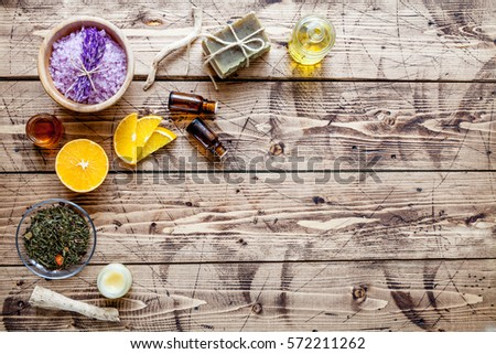 Organic orange cosmetics on wood background, top view #572211262