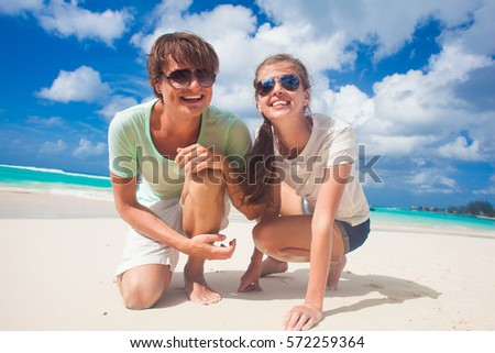 happy young couple having fun by the beach #572259364