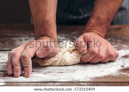 Bread Making Dough Knead Pastry Bakery Kitchen Man Cooking Process Concept #572310409