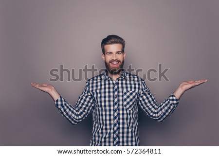Young happy bearded man gesturing with hands and showing balance. #572364811