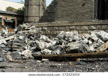 Interior of old factory buildings destroyed. Ruins of industrial enterprise, dark debris destroyed factory premises in factory as result of economic crisis and earthquake. #572433454