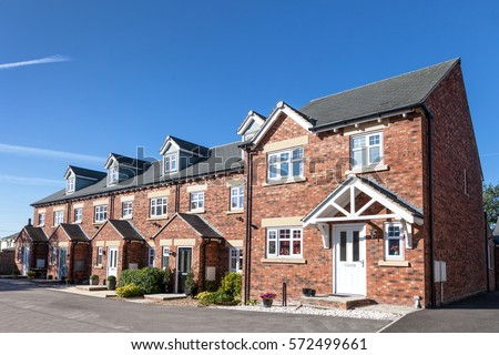 Row of new terraced houses Royalty-Free Stock Photo #572499661