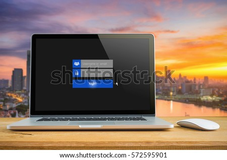 Laptop on table with login on touch screen, login box, user name and password inputs on digital display.   #572595901