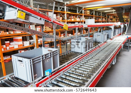 warehouse management system. Conveyer with automaticaly moving boxes #572649643