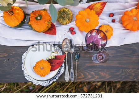 Autumn table setting. table setting with decorative pumpkins #572731231
