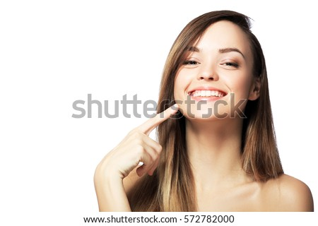 picture of beautiful woman pointing to teeth #572782000