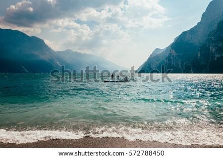 Scenic landscape of beautiful Garda lake and mountains, Italy. Nature background #572788450