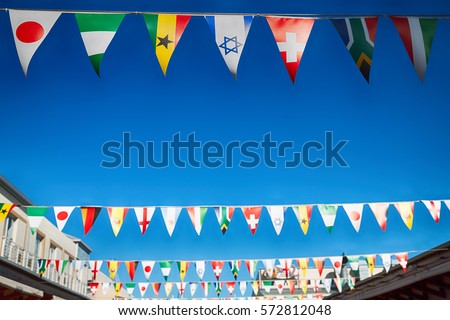 blur in south africa      decorative  waving flags from all over the world and sky