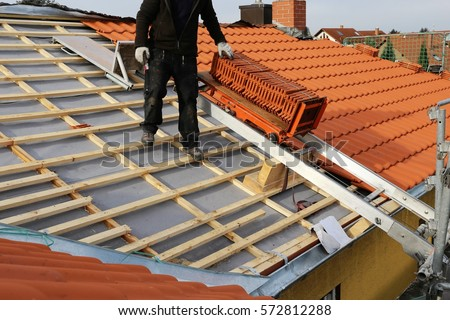 New roof construction on a residential home #572812288