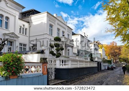 BOPPARD, GERMANY - NOVEMBER 06, 2016: White historic villas line up along the Rhein promenade. #572823472