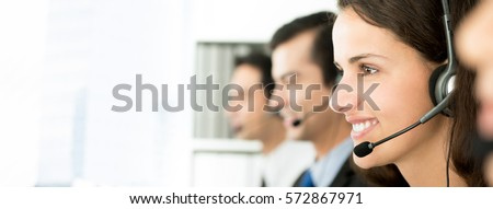 Smiling telemarketing customer service agents, call center job concept, web banner with copy space Royalty-Free Stock Photo #572867971