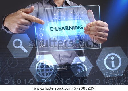 Business, Technology, Internet and network concept. Young businessman showing a word in a virtual tablet of the future: E-learning #572883289
